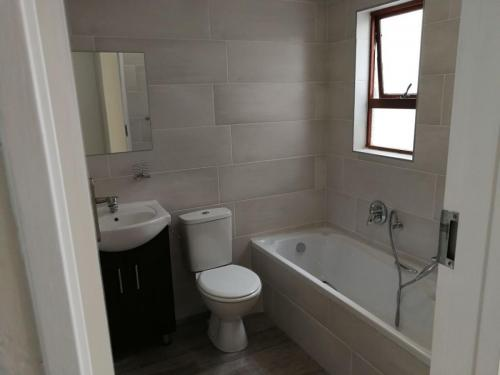 Bath sink and toilet and tiling of install
