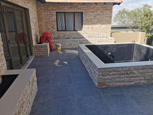outside stone tiling job (1)